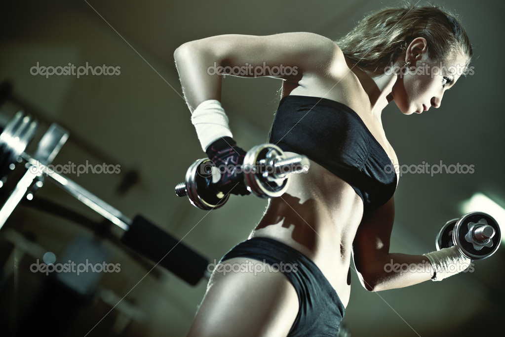 Young woman weight training. Camera angle view. — Photo #5040401