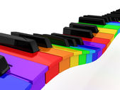 Rainbow piano over white background — Stock Photo