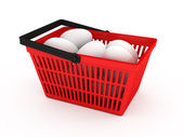 Shopping basket with eggs over white background — Stock Photo