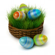 Stock Photo: Easter eggs in basket with grass