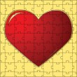 The red heart collected from puzzles — Imagens vectoriais em stock