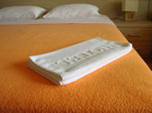 Hotel Towels On The Bed — Stock Photo