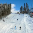 Ski track with chair lift in the mountains - Stock Photo