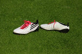Football boots on the grass — Stock Photo