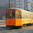 Old orange tram in Milan - Stock Photo