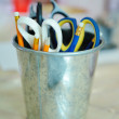 A bunch of art supplies jumbled up in a tin can — Stock Photo