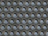 Metall mit löchern — Stockfoto