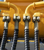 Excavator hydraulic tubes system — Stock Photo