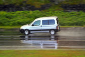 Car on wet road on high speed — Stock Photo