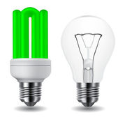 Energy saving green lightbulb and classic lightbulb — Stock Vector
