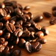Heap of burnt arabica coffee beans — Stock Photo