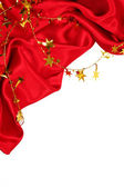 Smooth Red Silk with golden stars as holiday background — Stock Photo