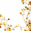 Holiday golden stars and spangles as background — Stock Photo