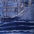 Blue jeans fabric with pocket as background — Stock Photo