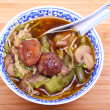 Vegetarian chinese soup with noodles and mushrooms - Stock Photo