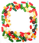Varios multicolores pastillas y cápsulas — Foto de Stock