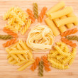 Different kinds of italian pasta on the wooden background — Stock Photo