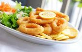 Deep batter fried squid rings calamari with green salad — Stock Photo