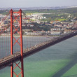 Portugal. Lisbon. The 25th of April Bridge - Stock Photo
