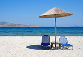 Greece. Kos island. Two chairs and umbrella on the beach — Stock Photo