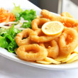 Deep batter fried squid rings calamari with green salad — Stock Photo #5183858