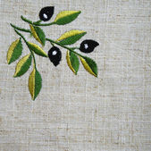 Embroidery of olive branch on linen beige fabric — Stock Photo