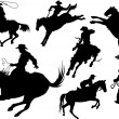 Vector de stock : Cowboys silhouettes
