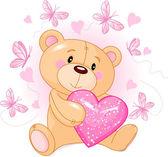 Teddy Bear with love heart — Stock Vector