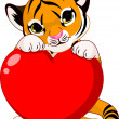 Cute tiger cub holding heart — Vector de stock