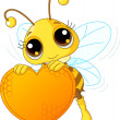 Cute bee holding a sweet  heart — Stock Vector