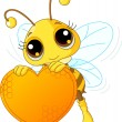 Cute bee holding a sweet heart — Vector de stock