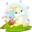Easter Bunny Hiding Eggs - Stock Vector