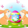 Stock Vector: Bunnies holds Easter Egg