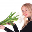 Beautiful young woman with tulips — Stock Photo