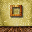 Old grunge room with wooden picture frames in Victorian style — Stock Photo #4025107