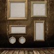 Old gold frames Victorian style on the wall in the room — Stock Photo #4090846