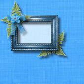 Wooden frame for photo with blue orchids and green fern — Stock Photo