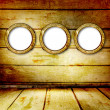 Grunge portholes on the ancient wooden background — Stock Photo