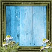 Grunge frame with bunch of flower on the wooden background — Stock Photo