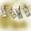 Dollars hanging from a rope on the abstract background. Conceptu — Stock Photo