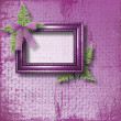 Wooden frame for photo with lilac orchids and green fern — Stock Photo