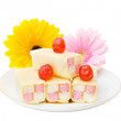 Tasty cakes with flowers — Stock Photo #5129111