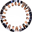 Group of business standing in huddle, smiling, low angle view — Stockfoto
