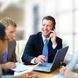 Business man speaking on the phone while in a meeting — Stockfoto #5207570