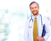 Closeup portrait of a happy senior doctor with stethoscope — Stock Photo