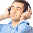 Man with headphones listening to music — Stock fotografie