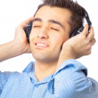 Man with headphones listening to music — Stock Photo