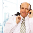 Mature executive man giving explanations and talking at phone mobile — Stock Photo