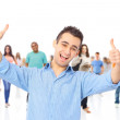 Young man showing thumbs up sign — Stock Photo