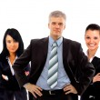 Stockfoto: Confident young business executive with his team in the background